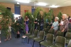 Placing palms at Altar