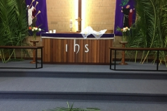 Palms in form of cross at base of Altar