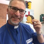 Pastor Matt with Martin Luther biscuit!